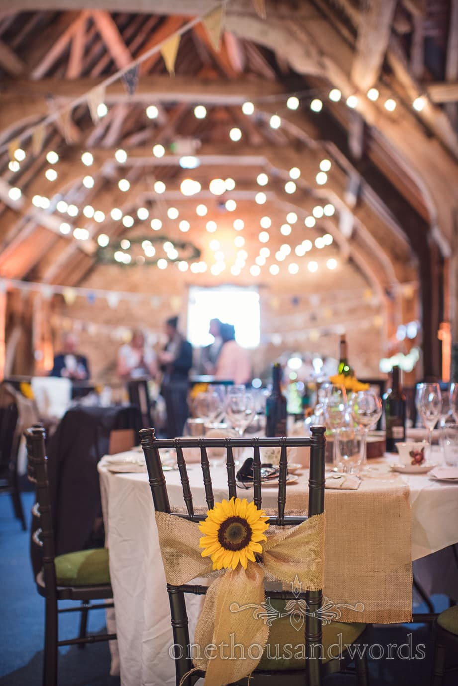 Sunflower and hessian chair sashes at Stockbridge Farm barn rustic wedding venue
