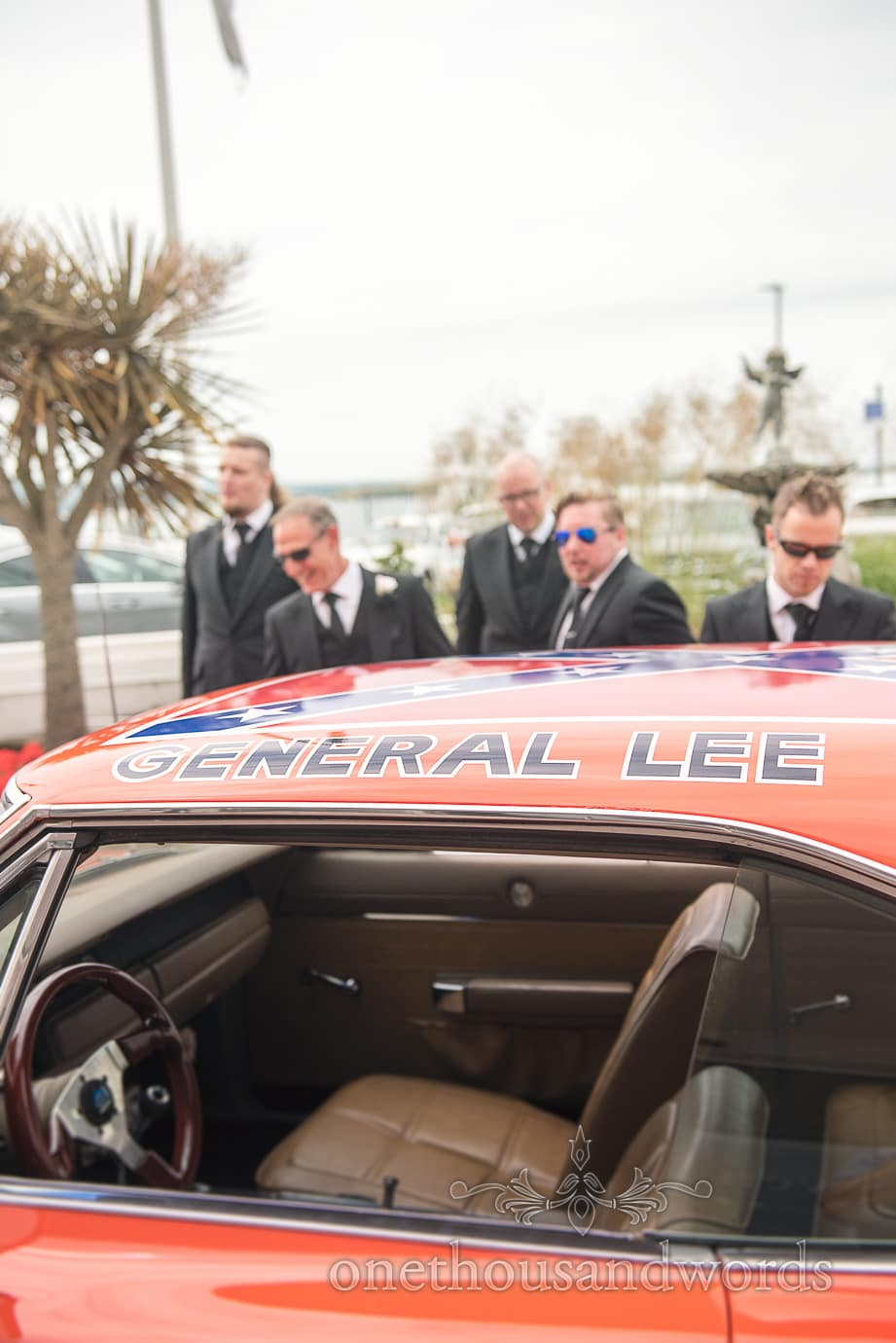 The General Lee wedding car roof with confederate flag and groomsmen on wedding morning