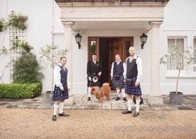 The groom and members of his party in front of house
