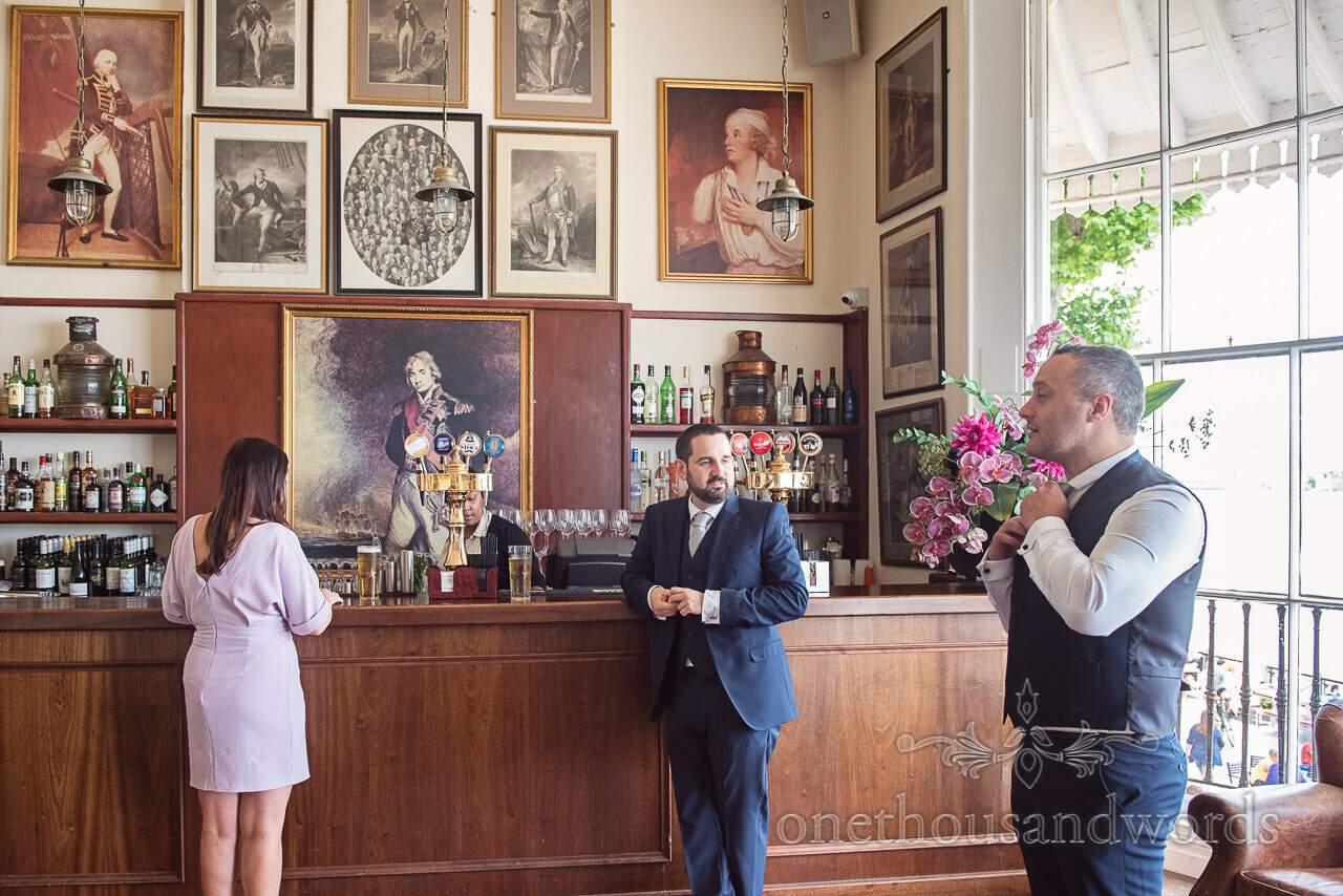 The groom in the Admirals gallery bar at Trafalgar Tavern Wedding venue