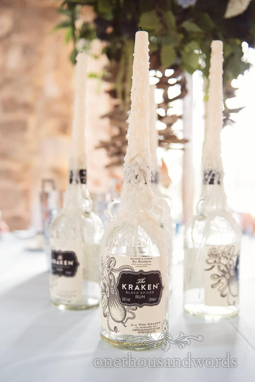 The Kraken spiced rum bottle candle holders at pirate themed wedding