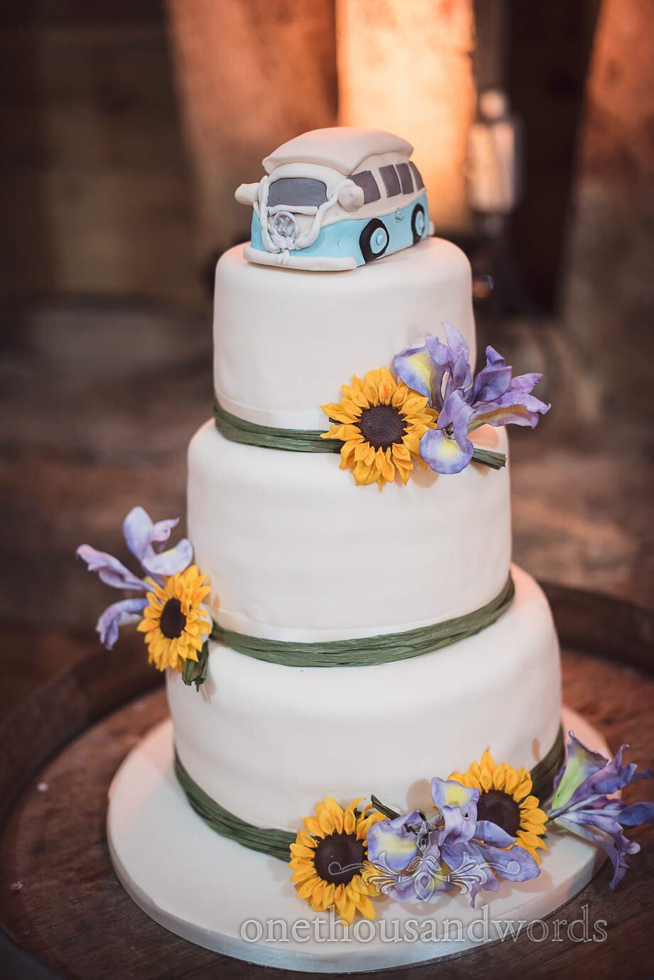 Three tier wedding cake with sunflower and VB bus decoration