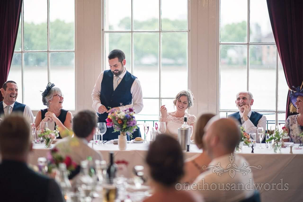 Top table laughter during grooms wedding speech at Trafalgar Tavern wedding