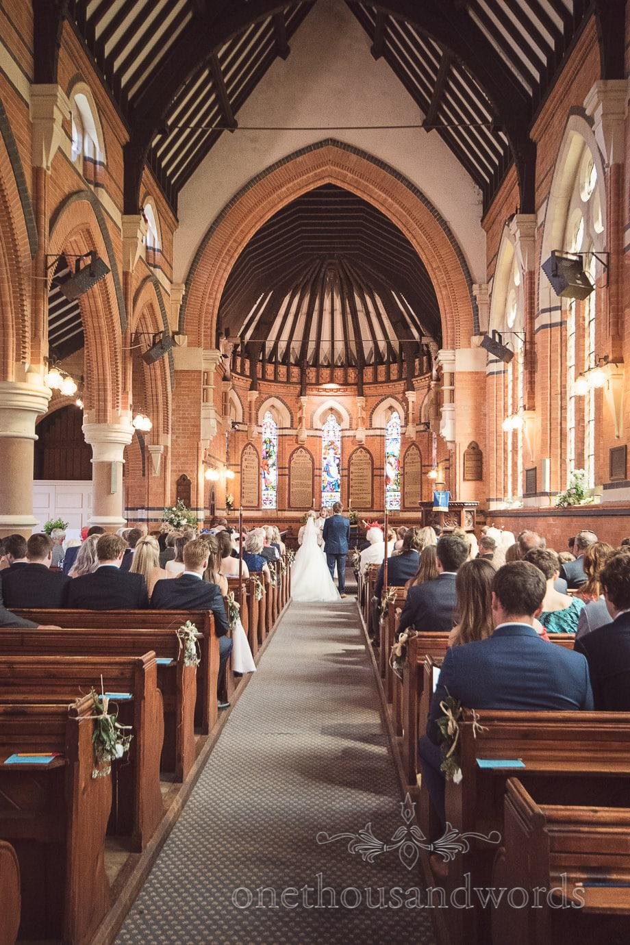 Wedding ceremony in beautiful English countryside church at Tur Langton