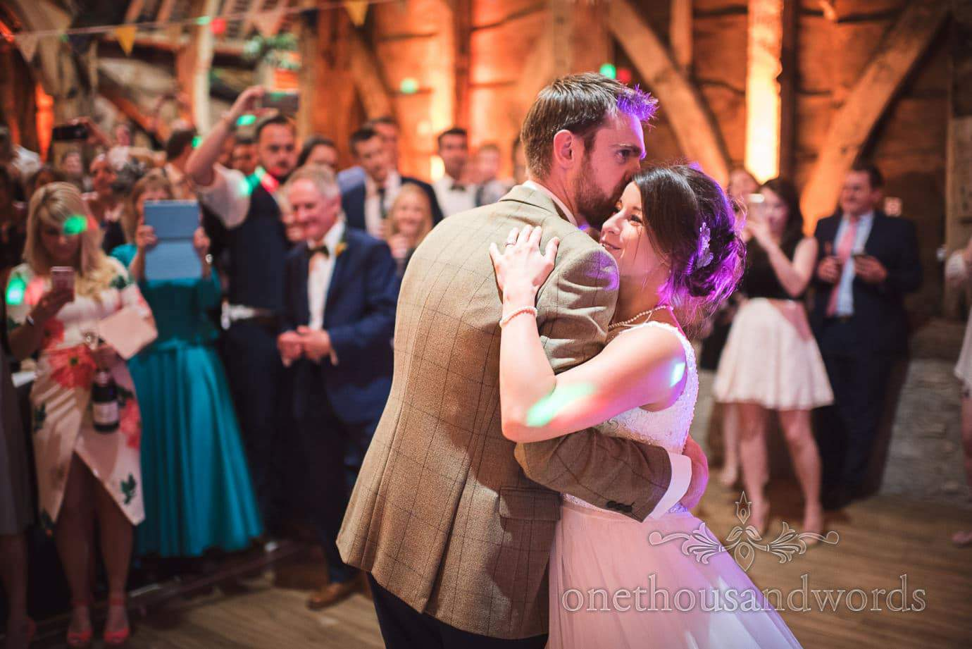 Wedding couple have first dance at rustic wedding venue in Sherborne