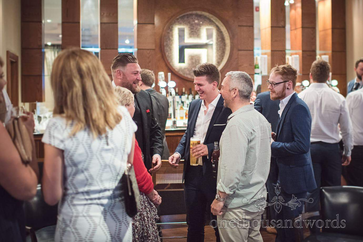 Wedding evening guests laughing at Haven Hotel Poole private bar