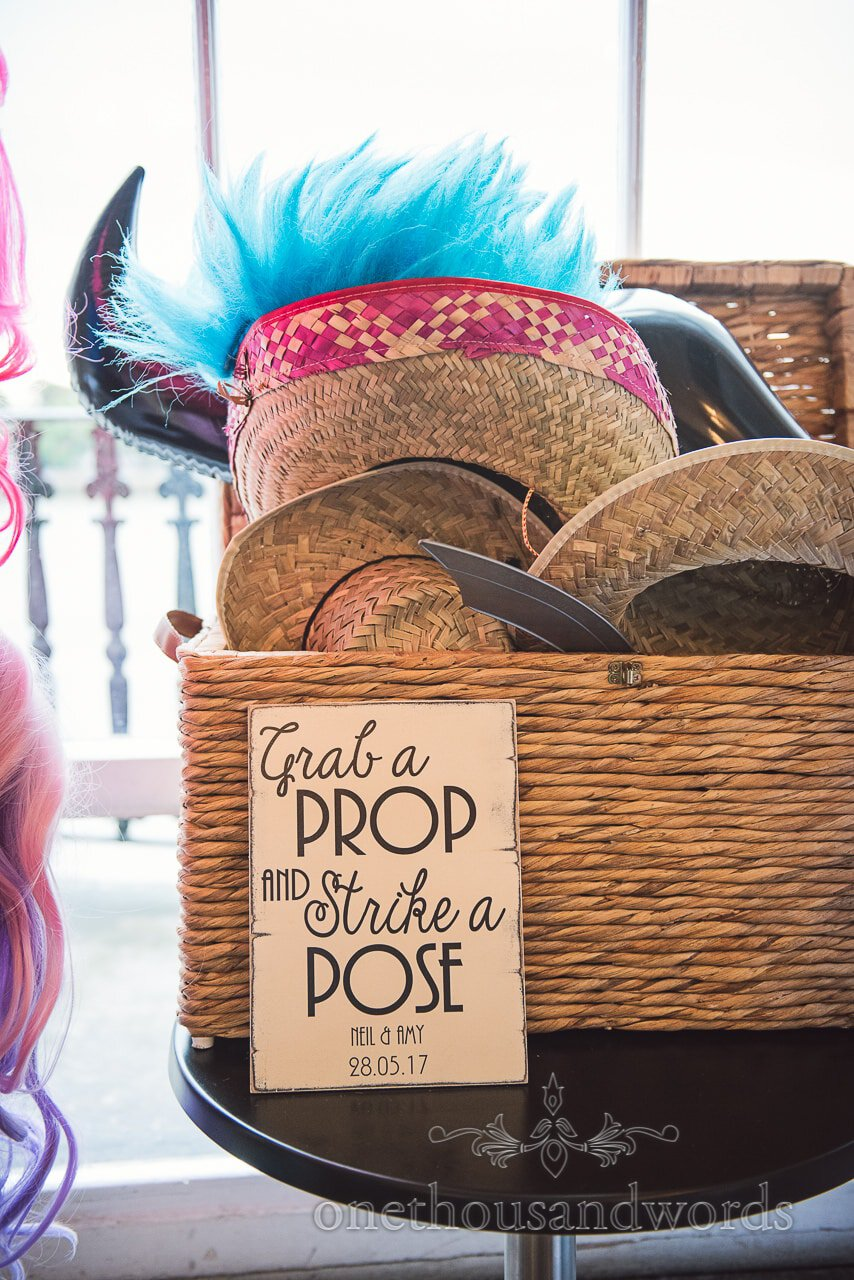 Wedding fancy dress box and Grab a prop and strike a pose sign