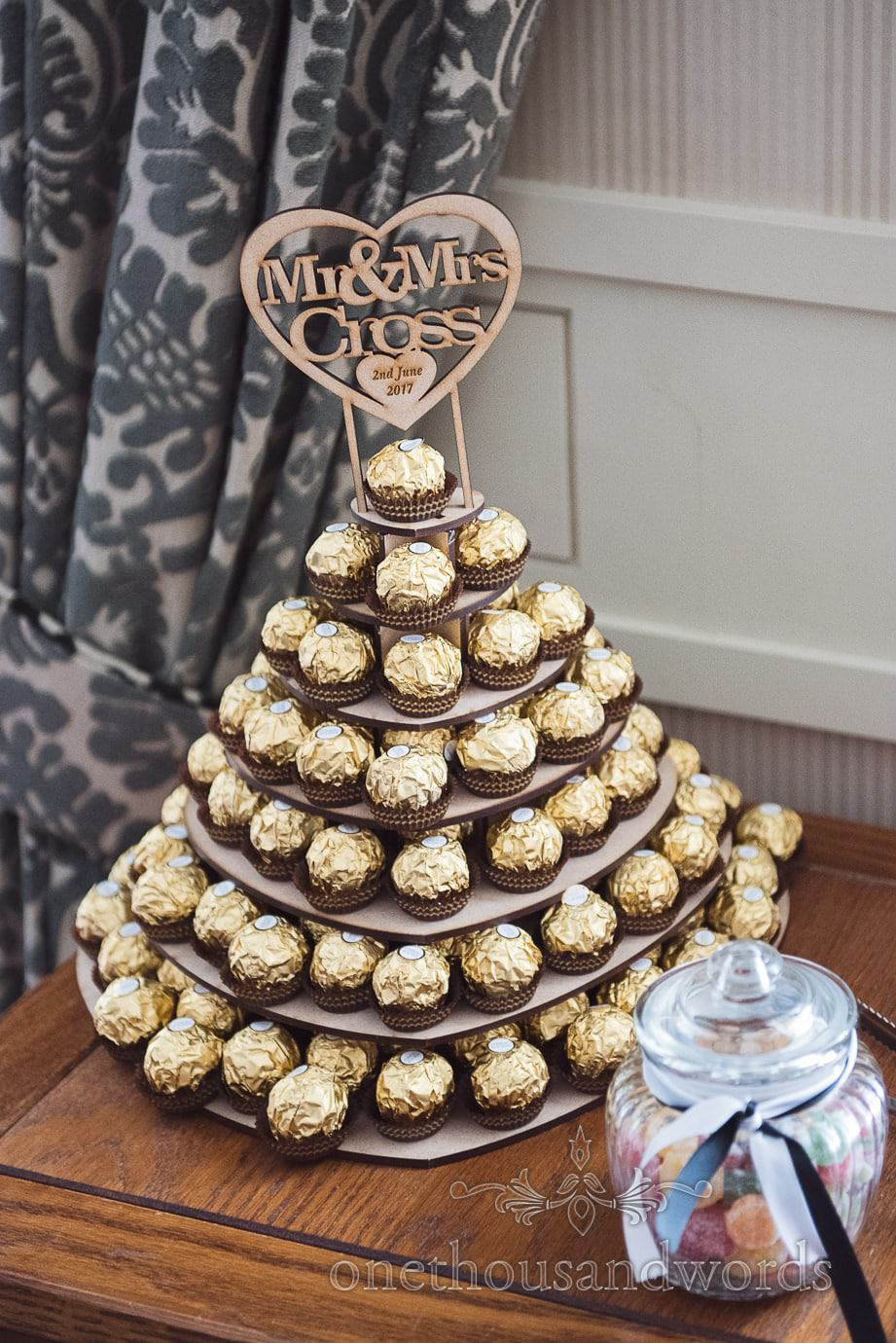 Wedding Ferrero Rocher on tiered lazer cut love heart wooden boards and lazer engraved love heart sign