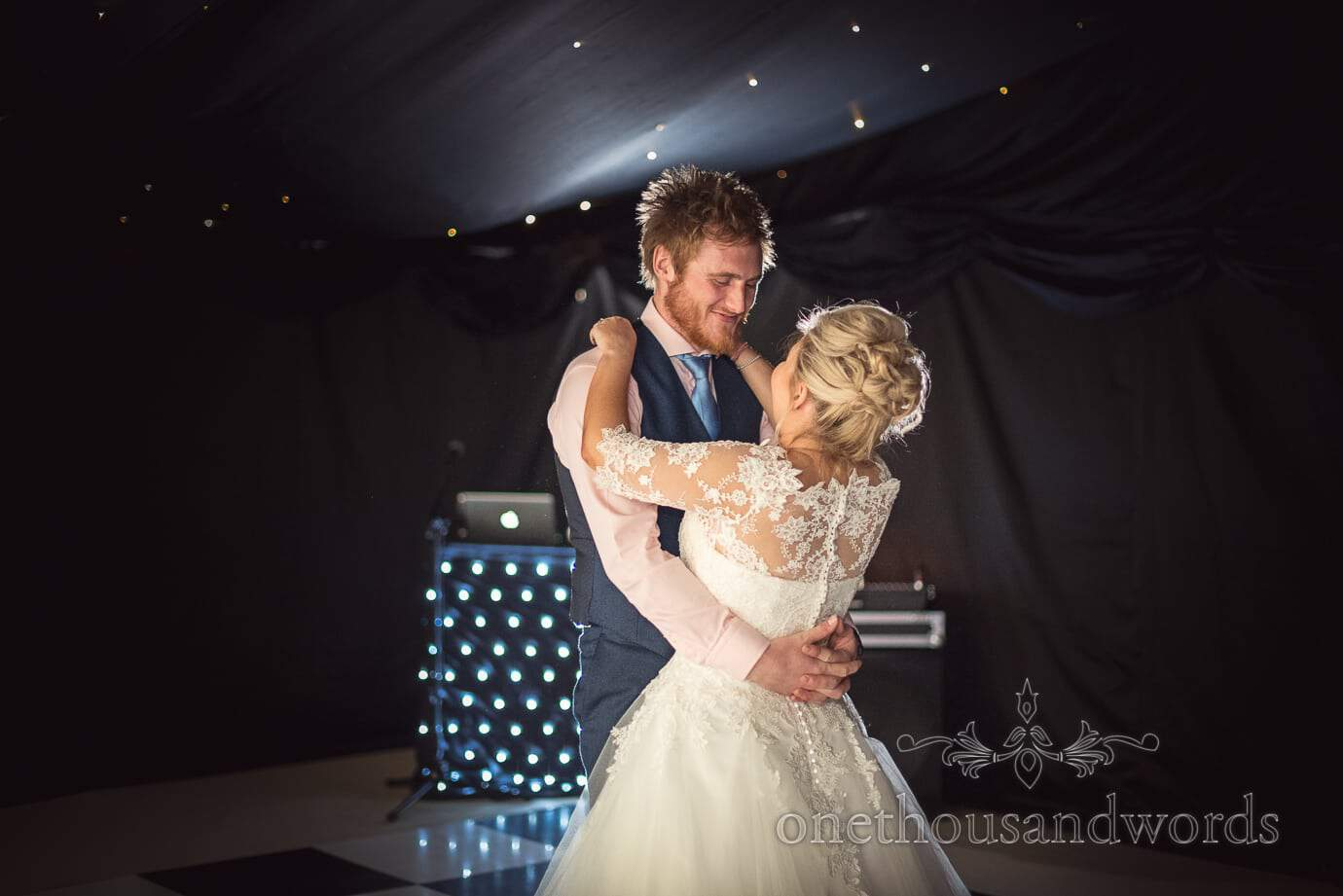 Wedding first dance in black walled wedding marquee with star cloth roof