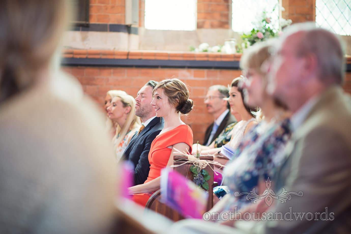 Wedding guest cries tears of joy during wedding ceremony in country church