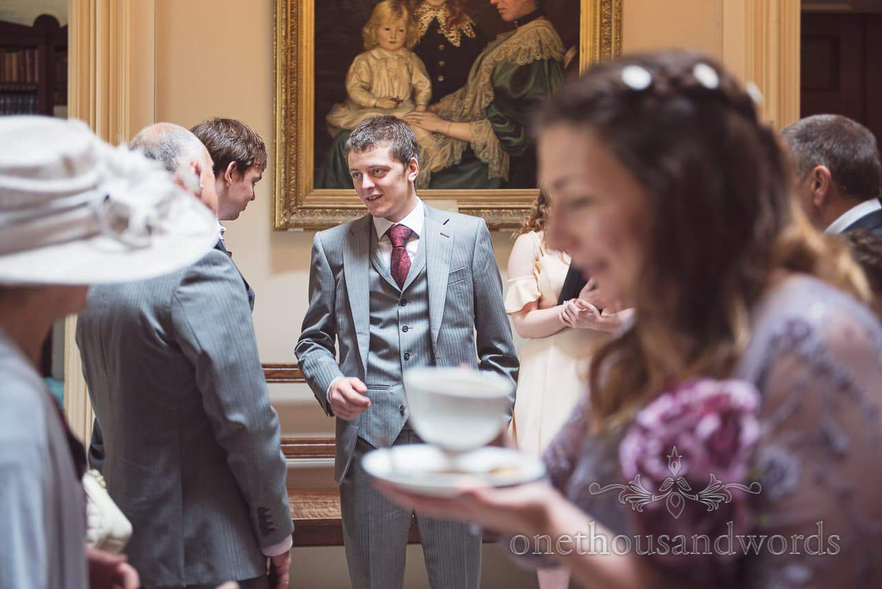 Wedding guest in 3 piece grey suit at Upton House wedding in Poole