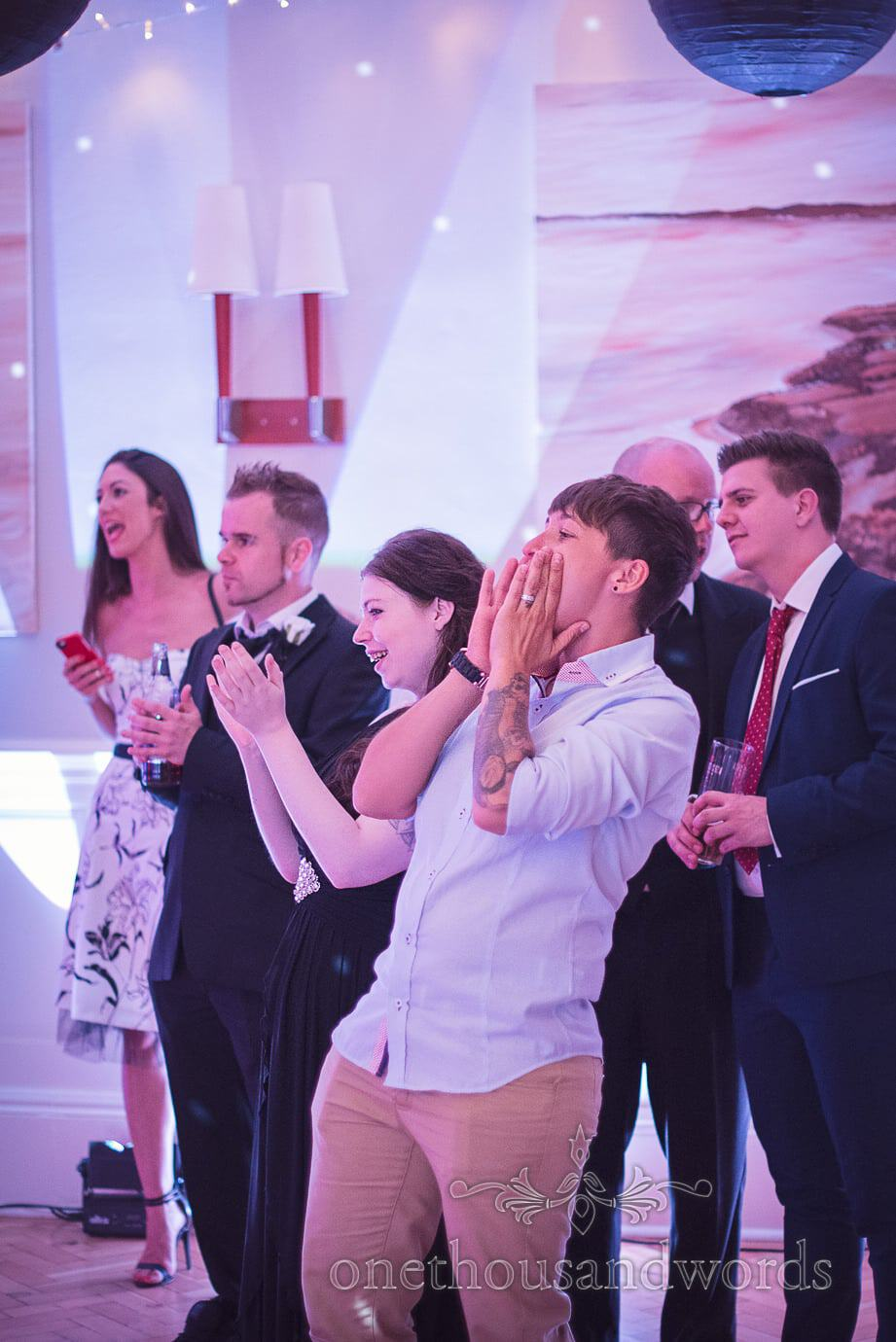 Wedding guests cheer and applaud during first dance at Haven Hotel Wedding