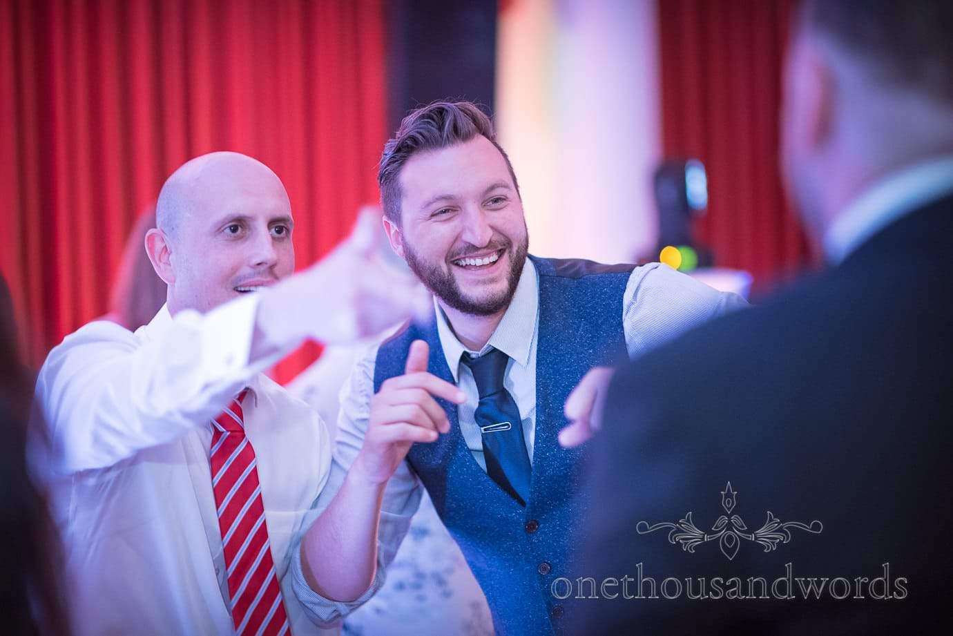 Wedding guests dancing at Haven Hotel Wedding venue in Poole, Dorset