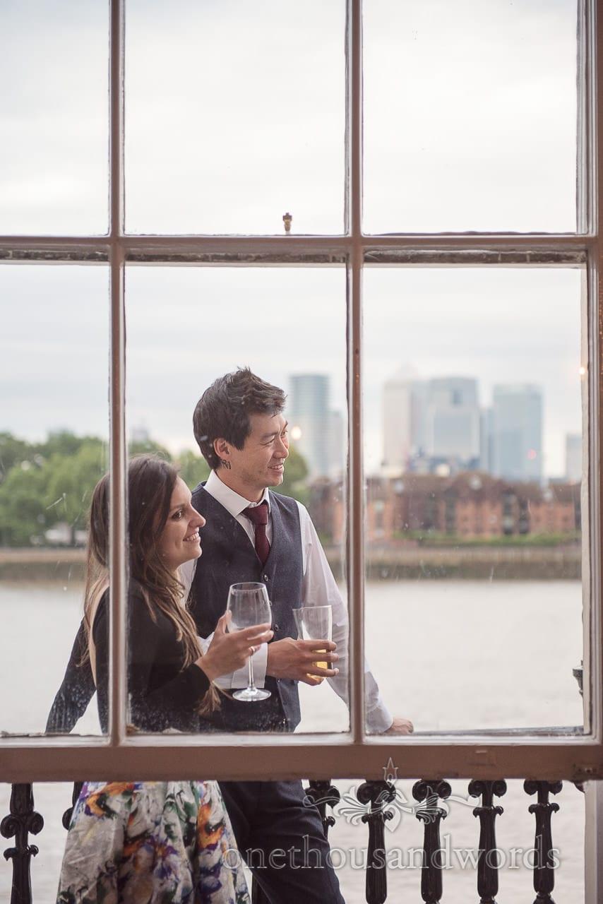 Wedding guests enjoying views across the Thames at Trafalgar Tavern Greenwich