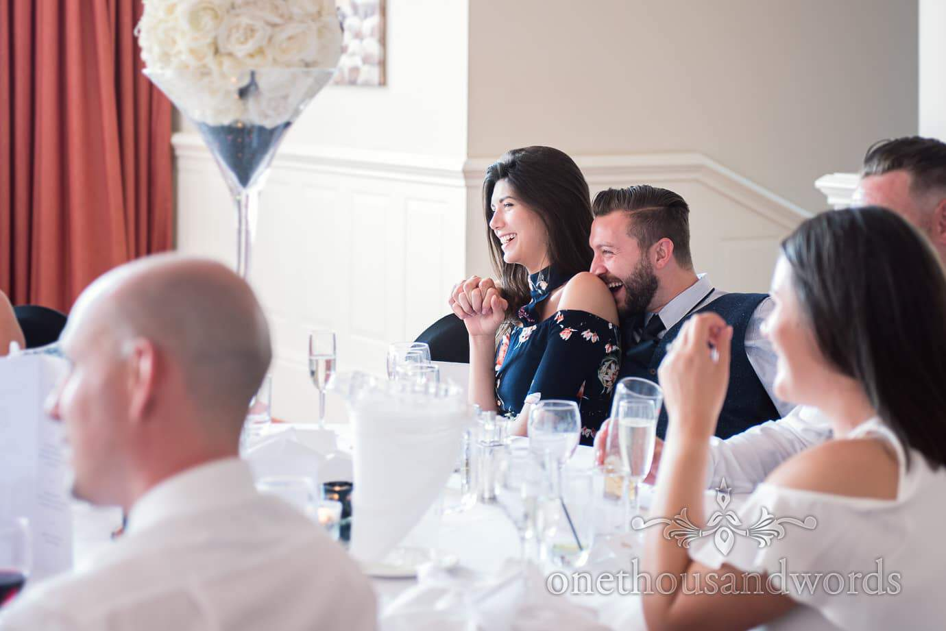 Wedding guests laughing at wedding speeches at Haven Hotel wedding breakfast
