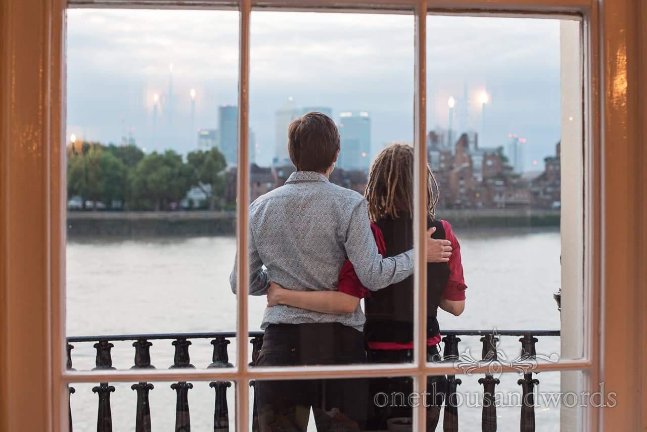 Wedding guests look over the Thames at Trafalgar Tavern Wedding venue evening
