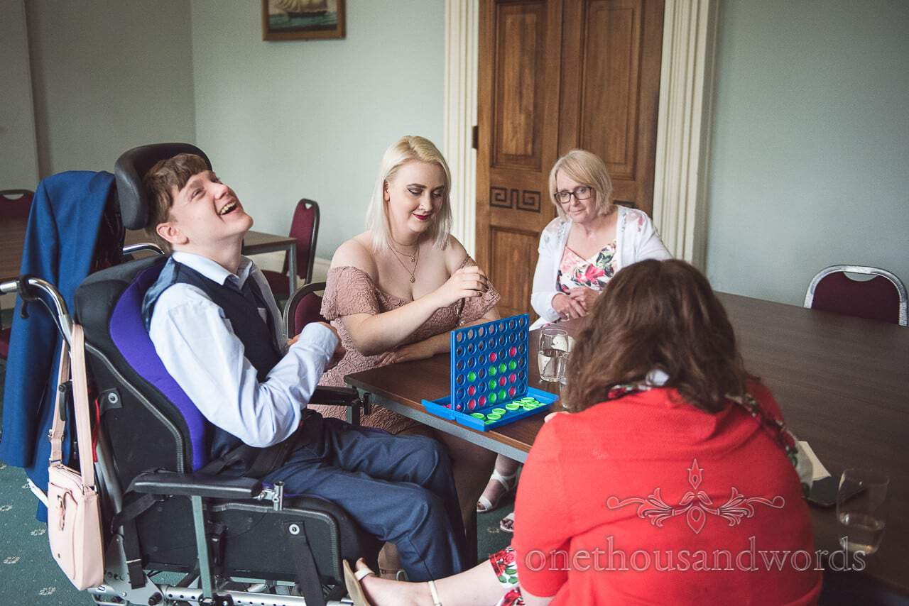 Wedding guests play connect 4 board game at Upton House wedding