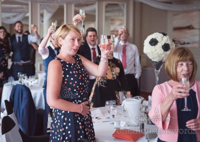 Wedding guests toast the speeches at Haven Hotel wedding venue in Dorset