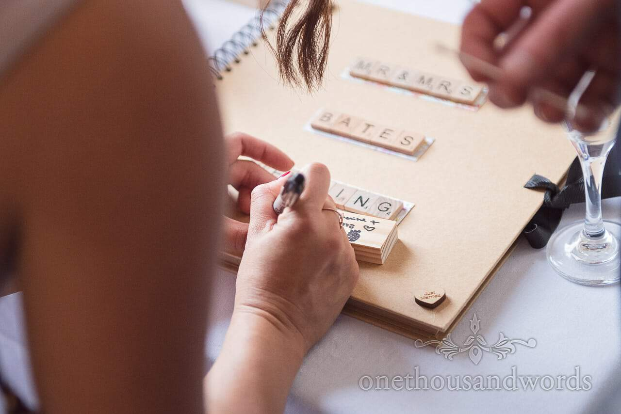 Wedding Jenga block messages and guest book with scrabble tile decoration