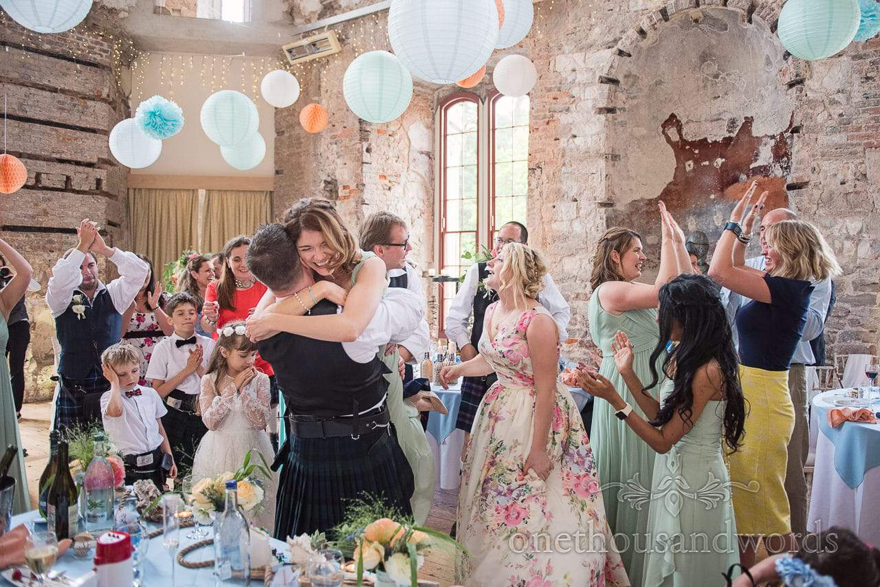 Wedding party celebrates successful flash mob dance at Lulworth Castle wedding