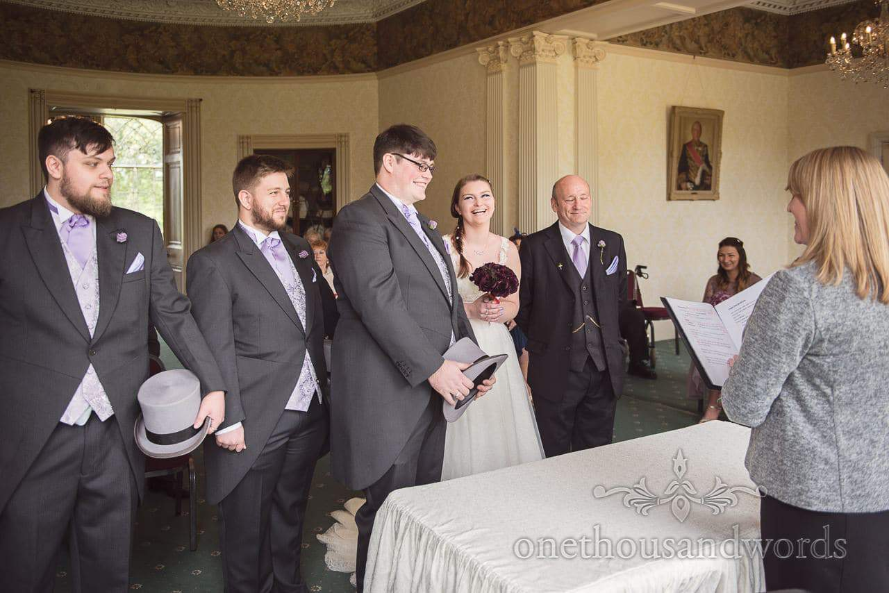 Wedding party during civil wedding ceremony at Upton House, country home wedding venue