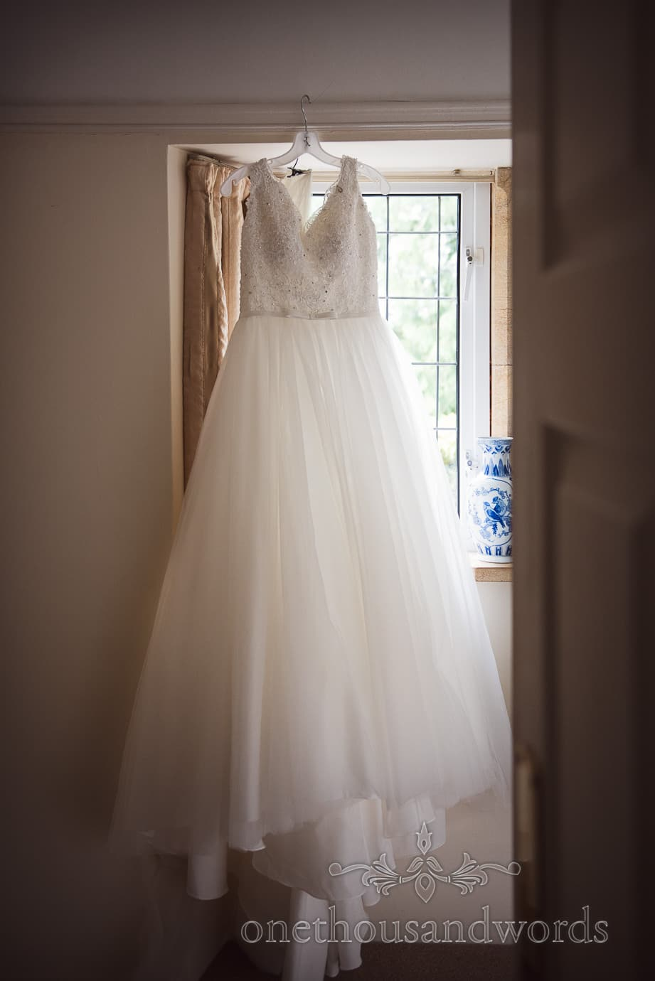 White A-line wedding dress with diamanté detail and appliqué bodice