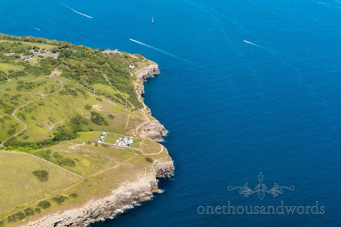 Aerial photograph of Durlston Lighthouse and coastline from wedding helicopter
