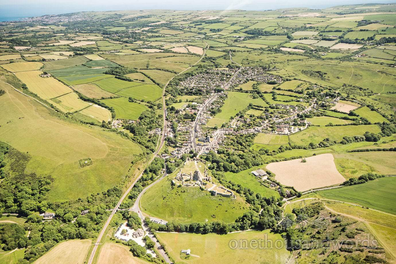 Aerial wedding photograph of Corfe Castle and Dorset countryside from wedding helicopter