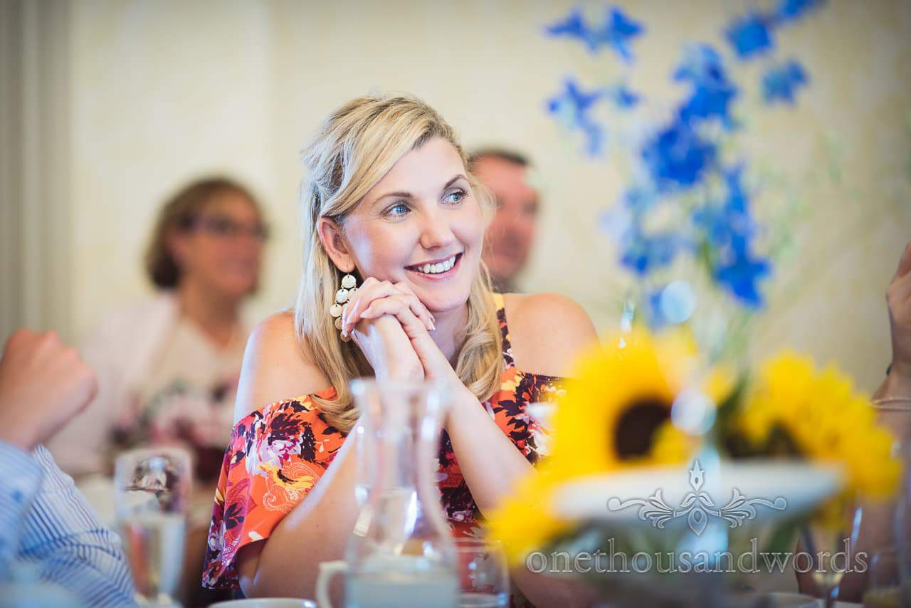 Beautiful wedding guest laughing at wedding speeches at Upton Country House wedding