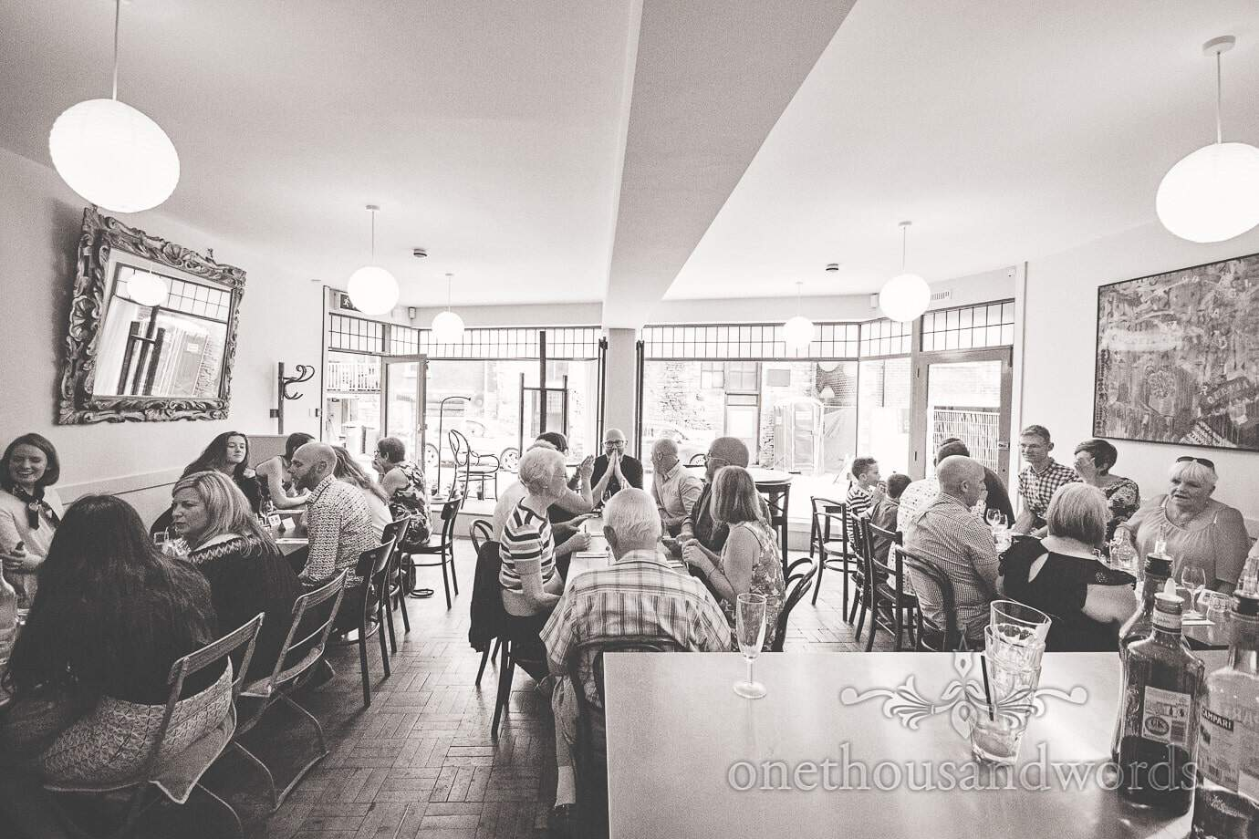Black and white photograph of pre-wedding meal in Swanage restaurant in Dorset