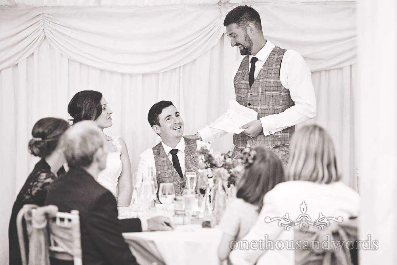 Black and white wedding speeches photograph at The Old Vicarage marquee wedding