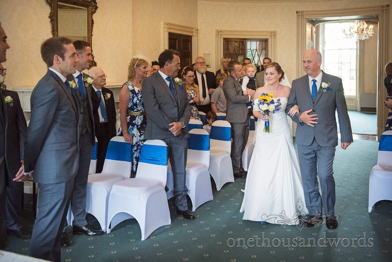 Bride and father walk up the aisle at Upton House civil wedding ceremony in Dorset