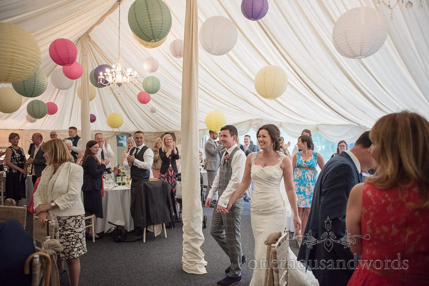 Bride and groom clapped into wedding marquee at The Old Vicarage Wedding venue