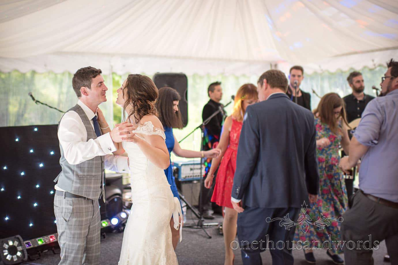 Bride and groom dance with wedding guests at The Old Vicarage marquee Wedding