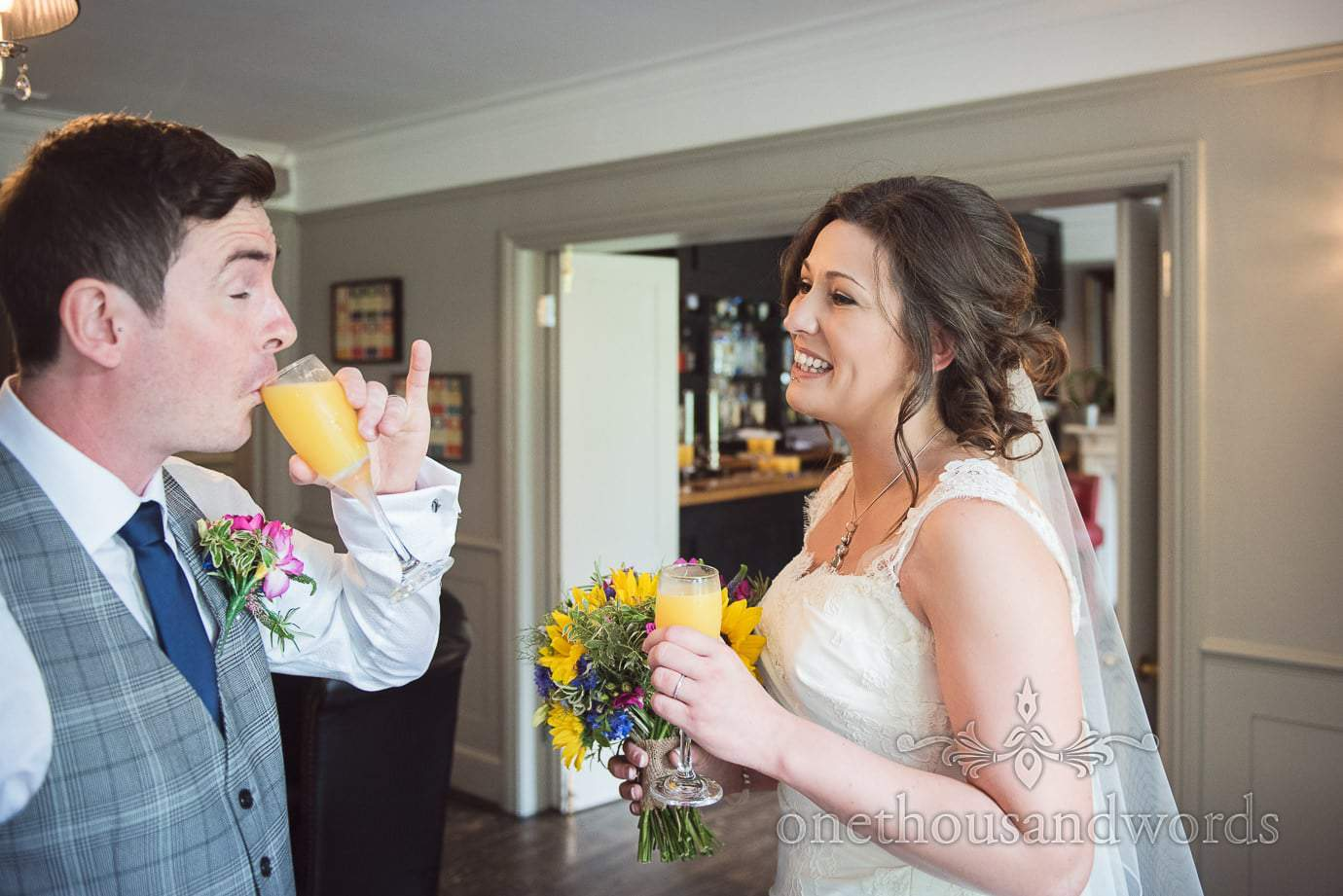 Bride and groom enjoy a drink in the bar at The Old Vicarage Wedding in New Forest