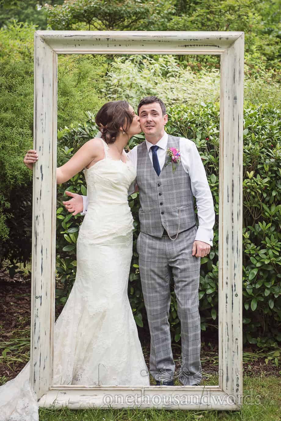 Bride and groom in white distressed picture frame at The Old Vicarage Wedding venue