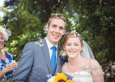 Bride and groom portrait with confetti in their hair at blue and yellow themed wedding