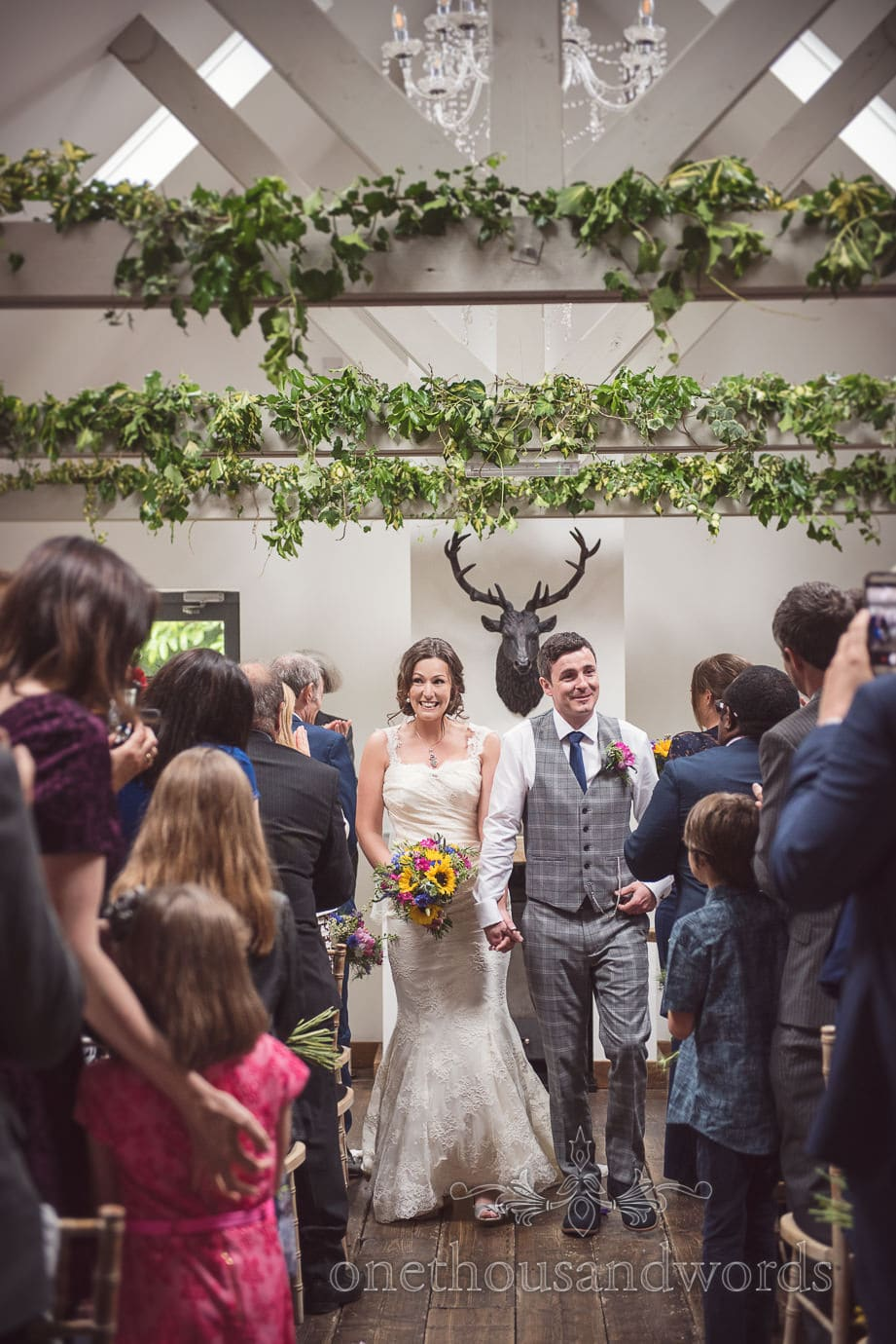 Bride and groom walk down the aisle at The Old Vicarage Orangery wedding ceremony