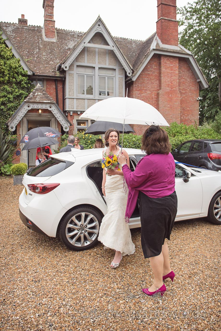 Bride arrived under umbrella at The Old Vicarage Wedding venue in New Forest
