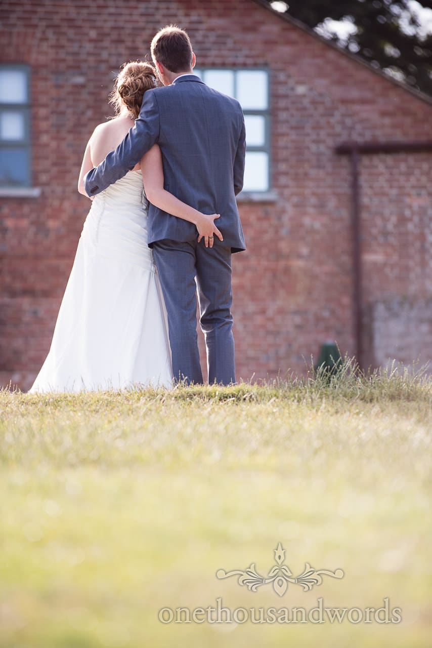 Bride grabs grooms bottom during couple photographs at Upton Country house wedding
