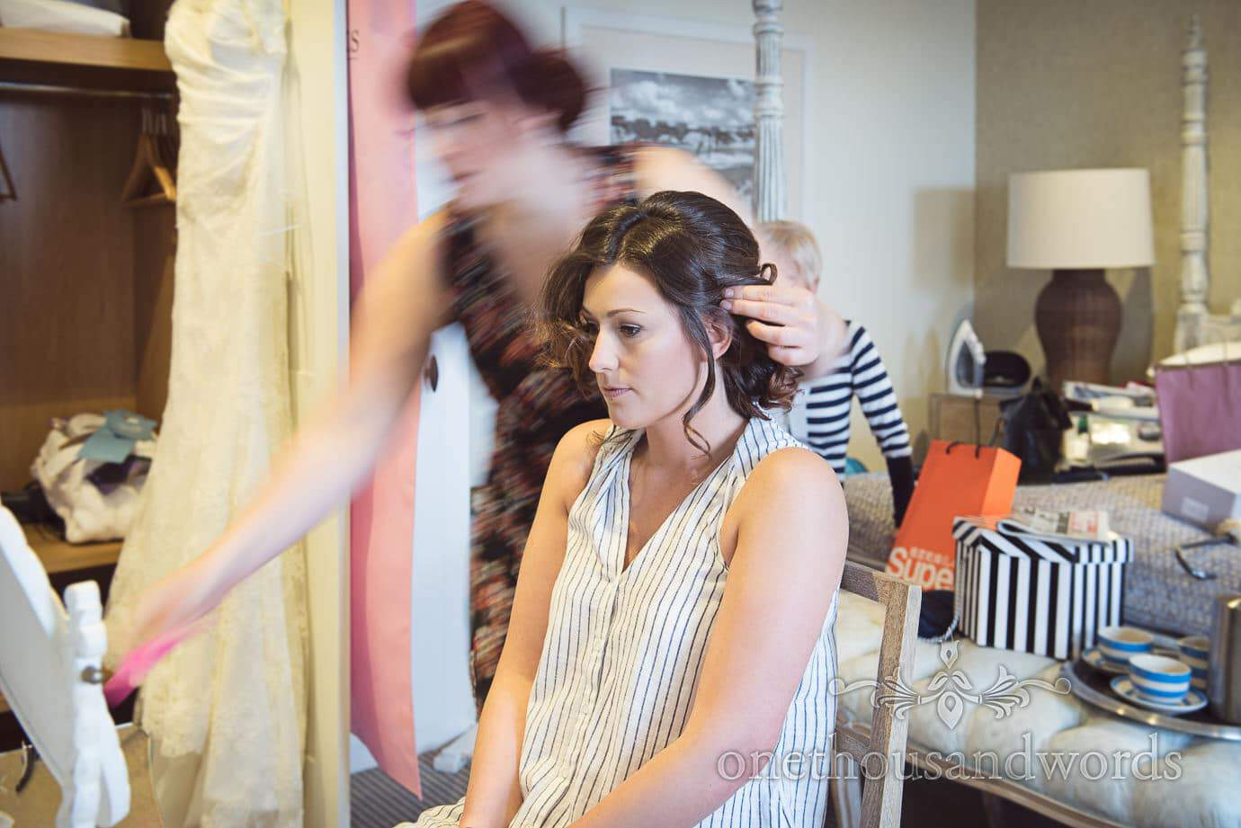 Bride has wedding hair styled at Christchurch Harbour Hotel with movement