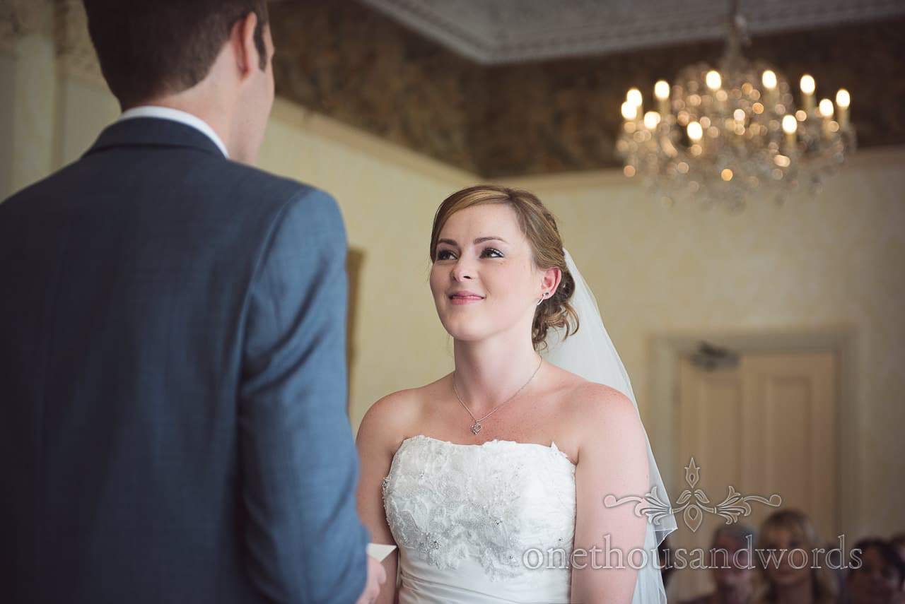 Bride portrait photograph with chandelier at Upton House wedding ceremony