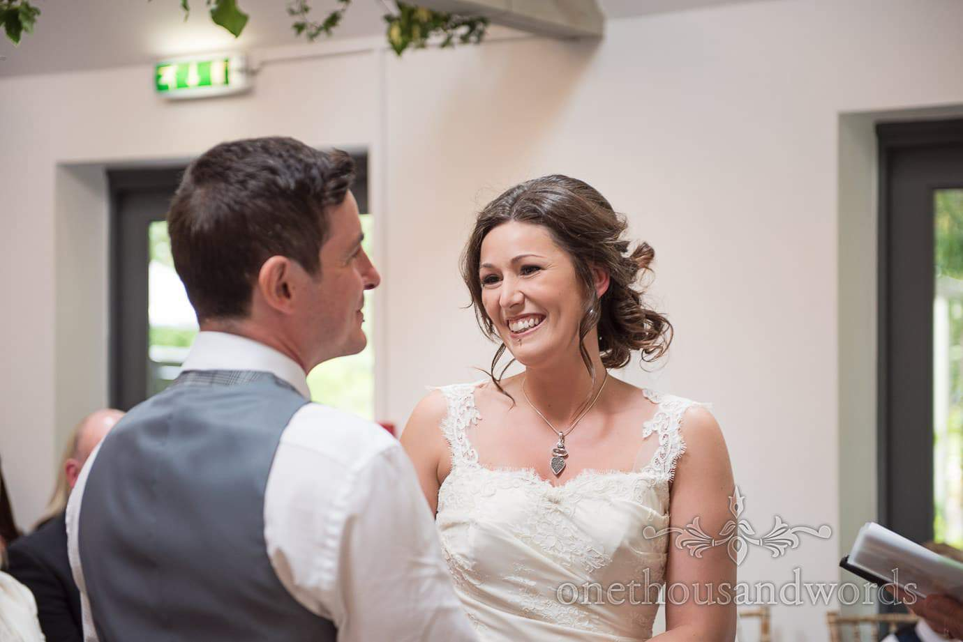 Bride smiles at groom during The Old Vicarage wedding ceremony in New Forest