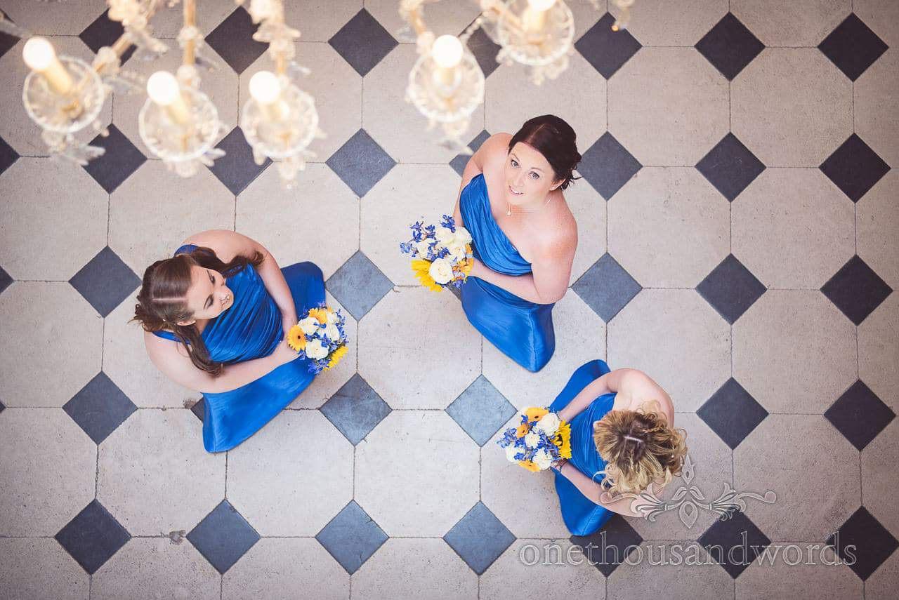 Bridesmaid in blue bridesmaids dresses photographed from above with chandelier