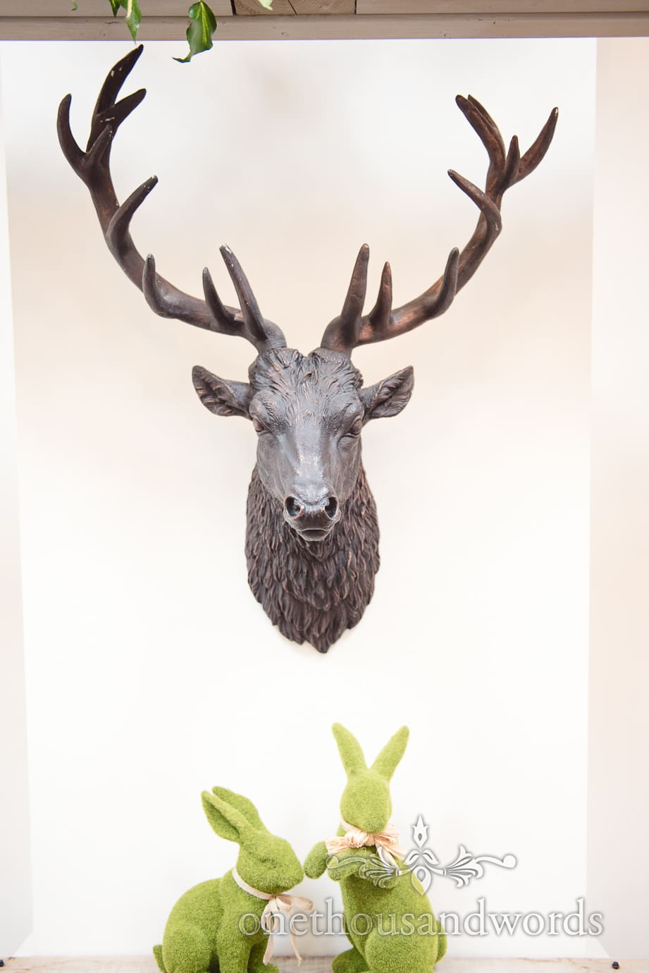 Bronze stag head and grass rabbits at The Old Vicarage wedding ceremony