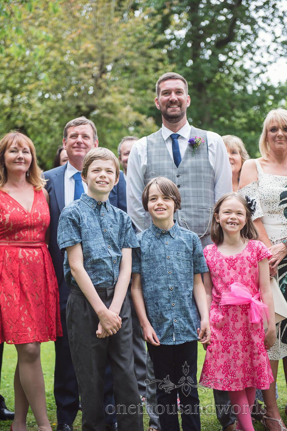 Child wedding guest in matching shirts at The Old Vicarage Wedding group photographs
