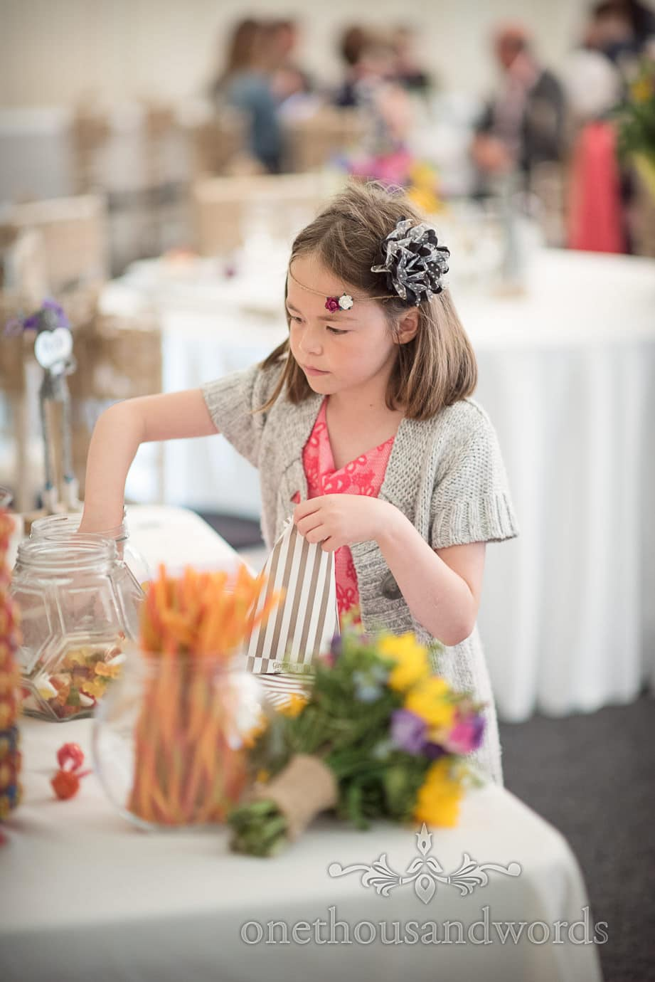 Child wedding guest with flowers in hair raids sweet table at The Old Vicarage Wedding