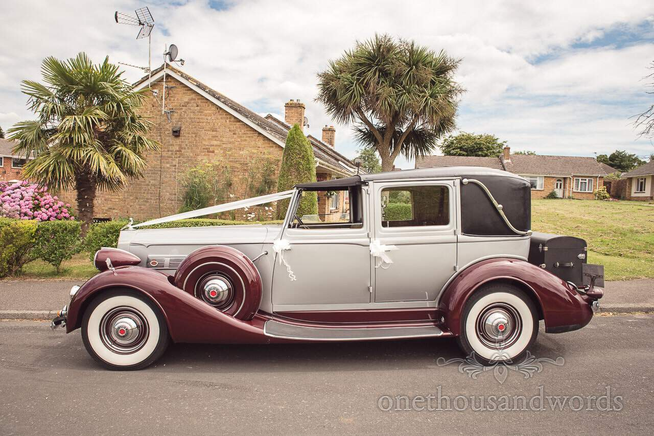 Classic burgundy and grey Daimler wedding car transport from RR Elite in Dorset