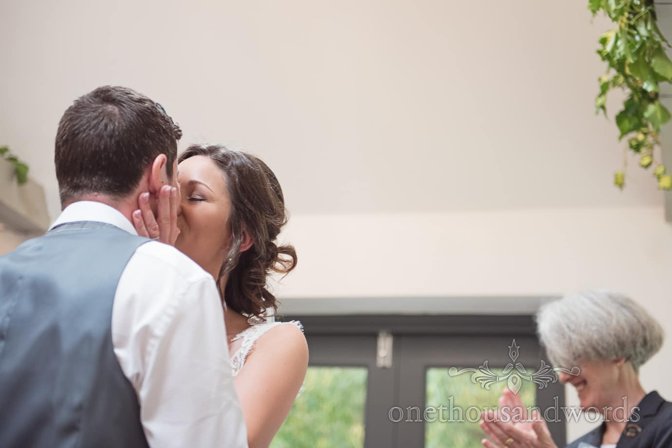 Close up photograph of first kiss at The Old Vicarage Wedding ceremony in New Forest