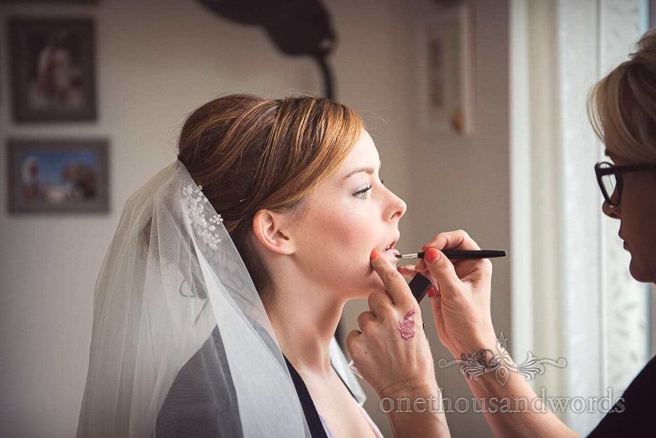 Documentary photograph of bridal wedding make up on wedding morning preparation